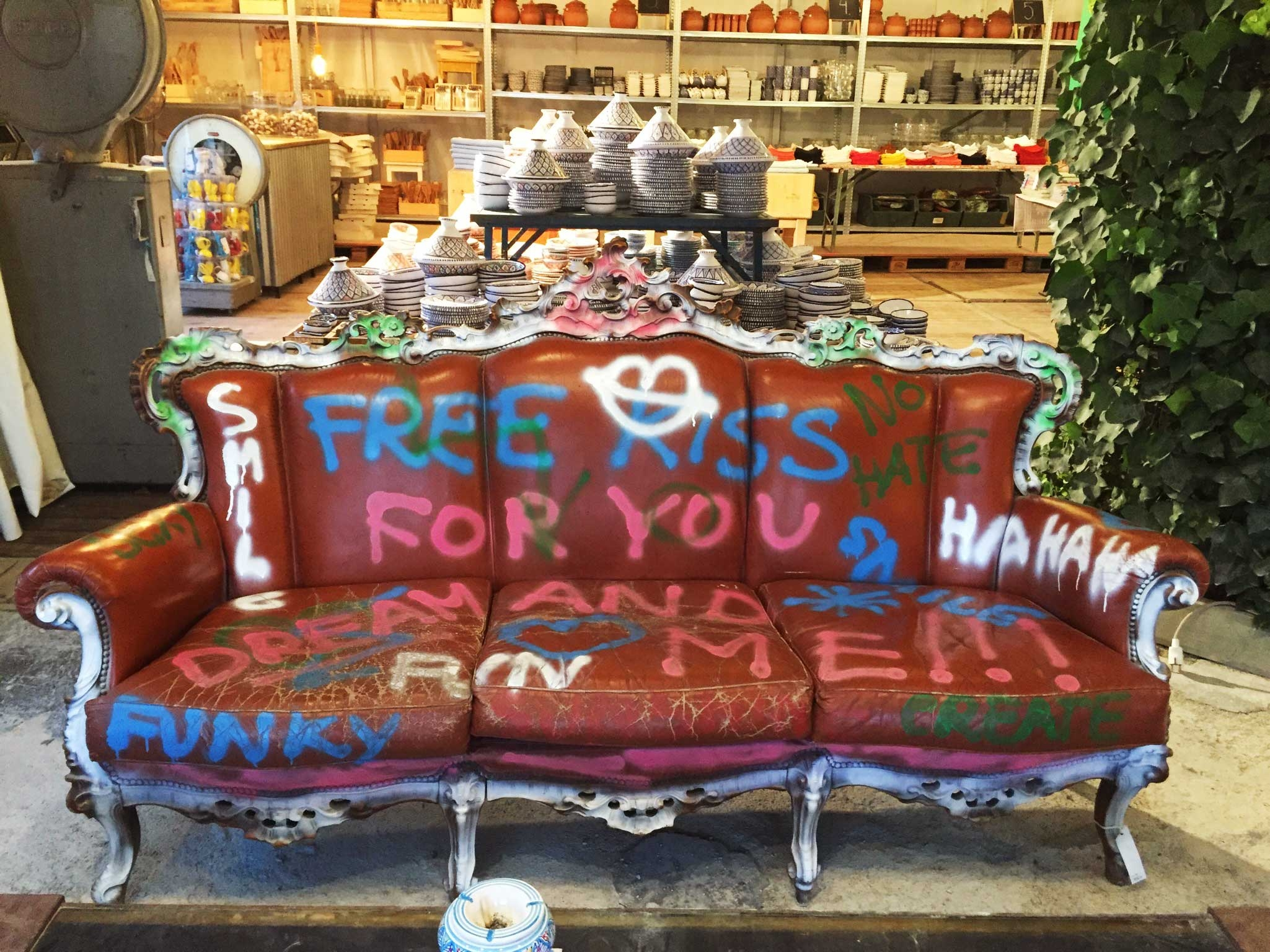 Funky homeware and a graffitied couch at Sluiz