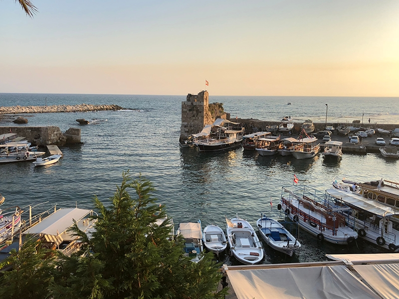Sunset over the harbour in Jbeil, an ancient beachside town