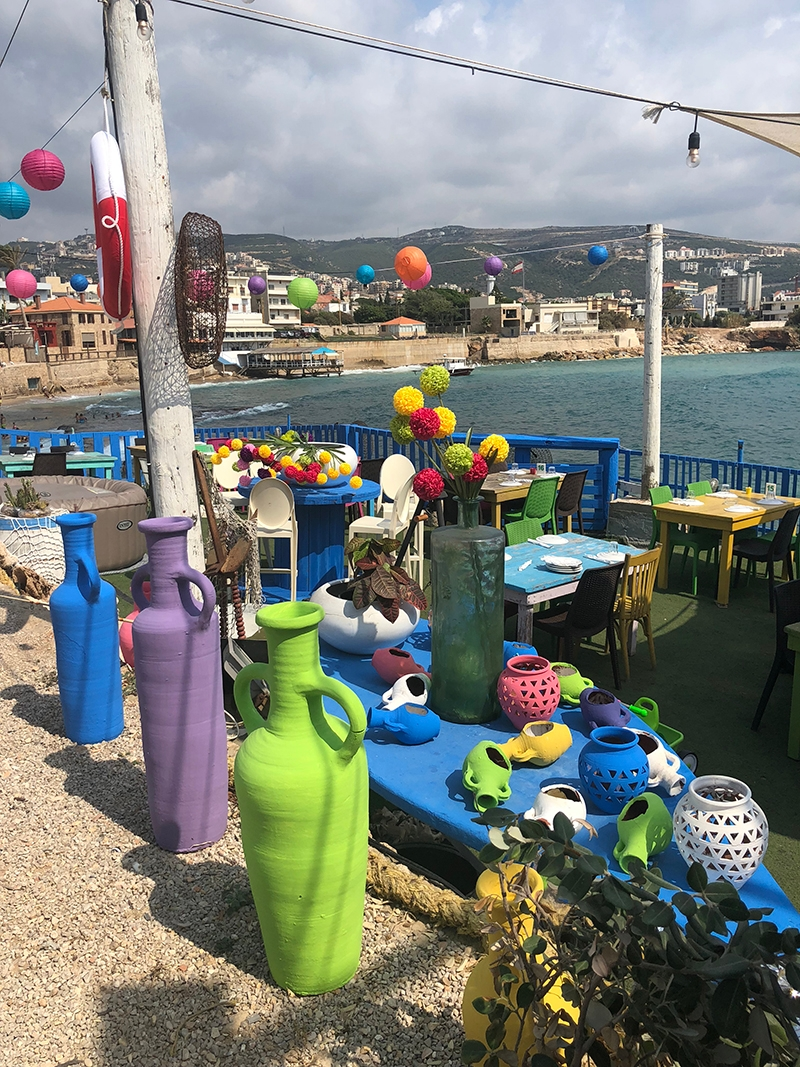 A colourful display of vibrant pots and urns along the coast of Batroun