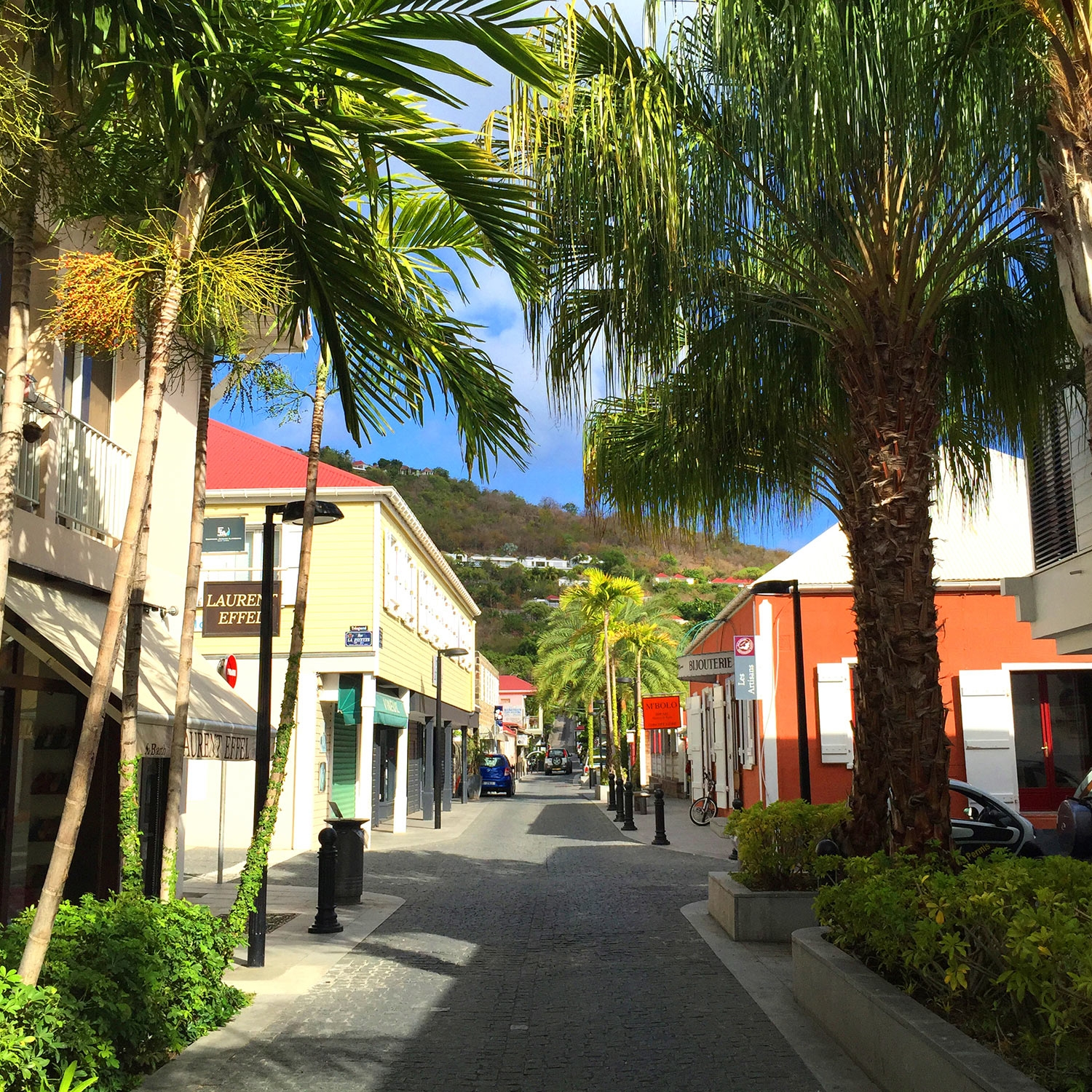 The colourful streets of St Barths are lined with bright green palms