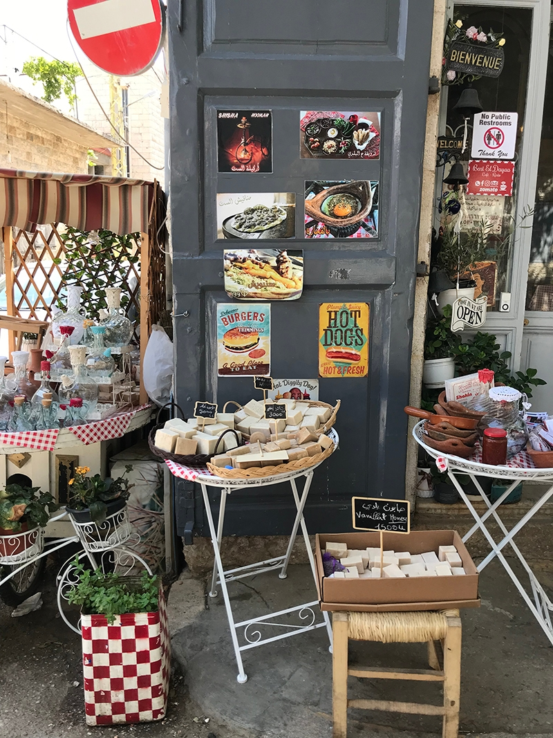 An outdoor market with various stands of homemade items