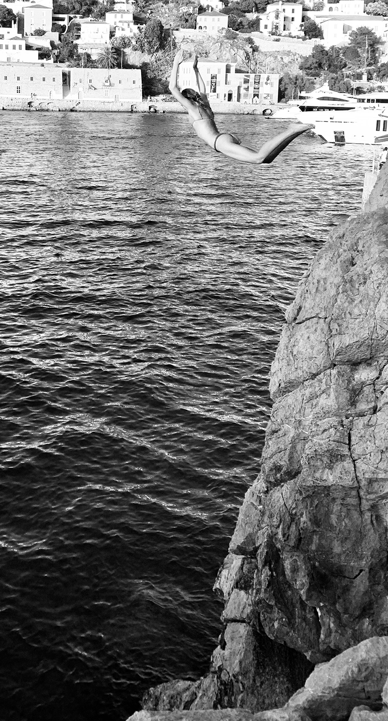 Cliff diving into the ocean