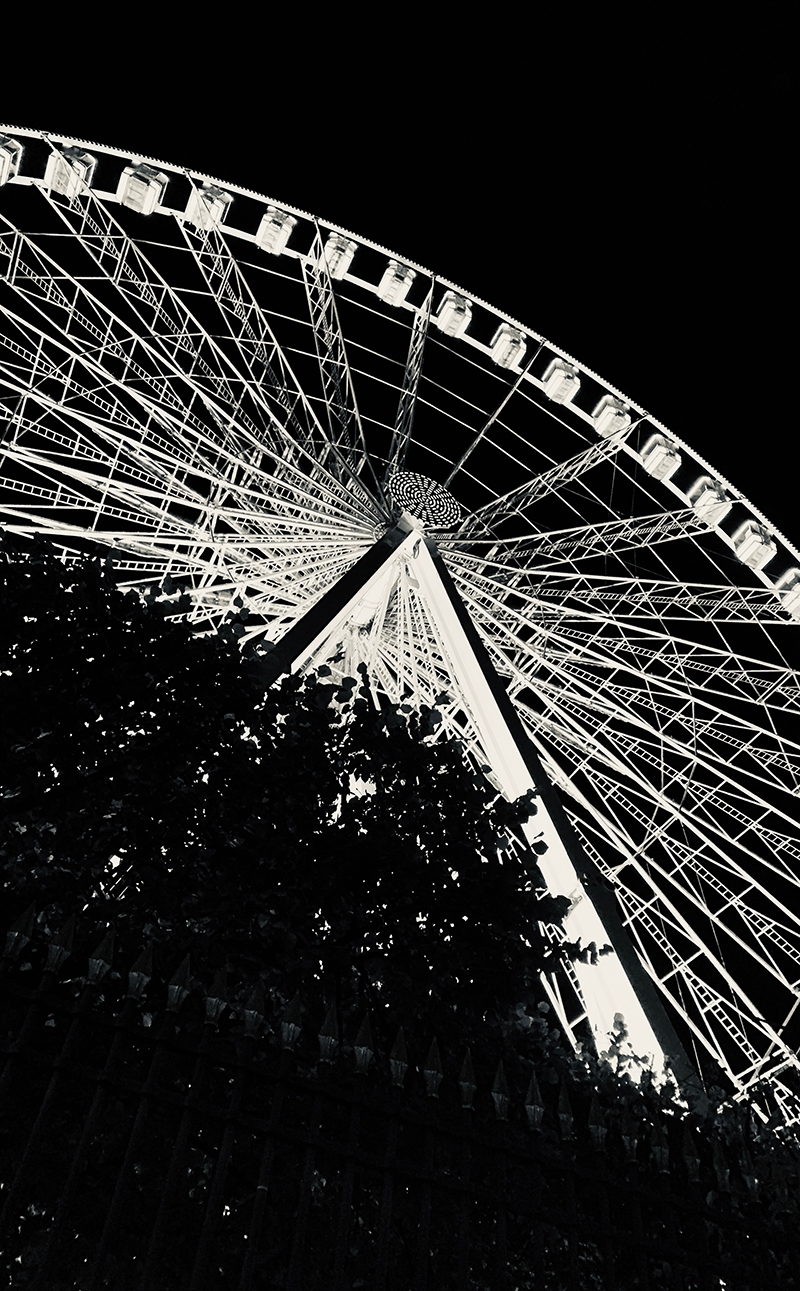 A black and white image of a Ferris Wheel. 2019