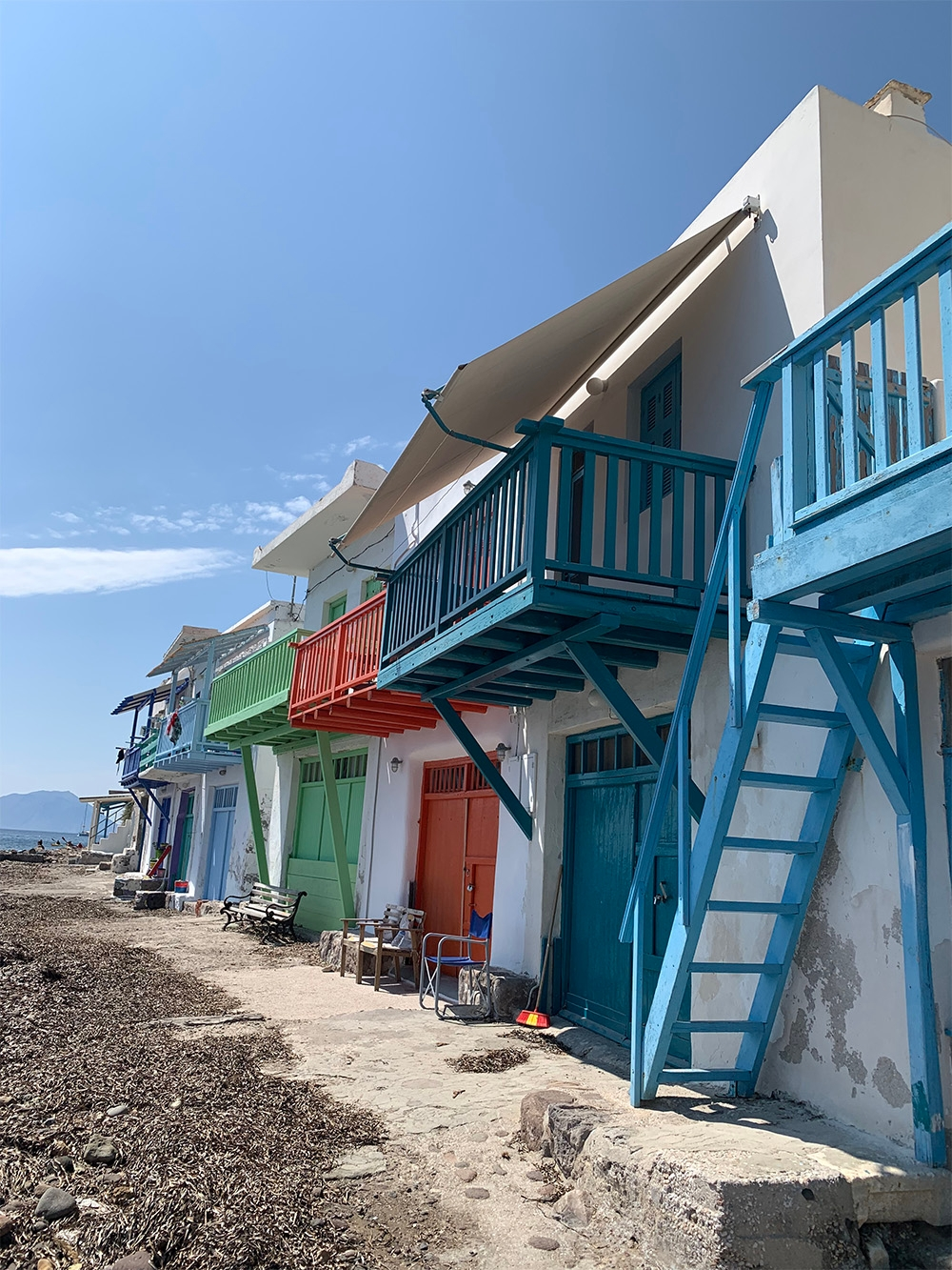 Colourful boat houses brighten the Milos streets.