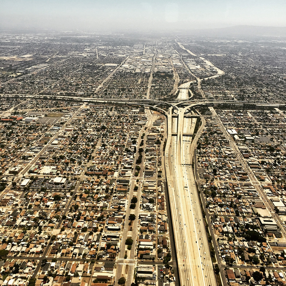 An aerial view of the freeways and buildings of Los Angeles