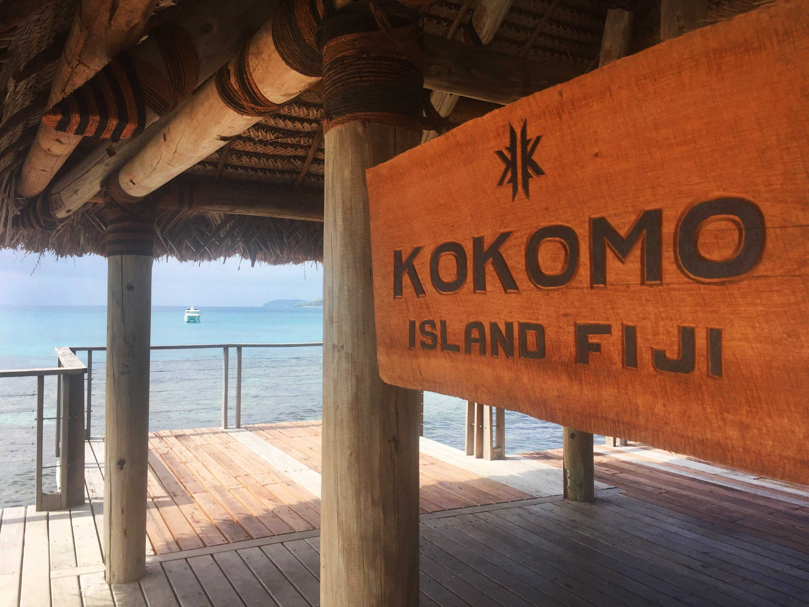 "The welcome sign in a wooden hut reads ""Kokomo Island Fiji"""