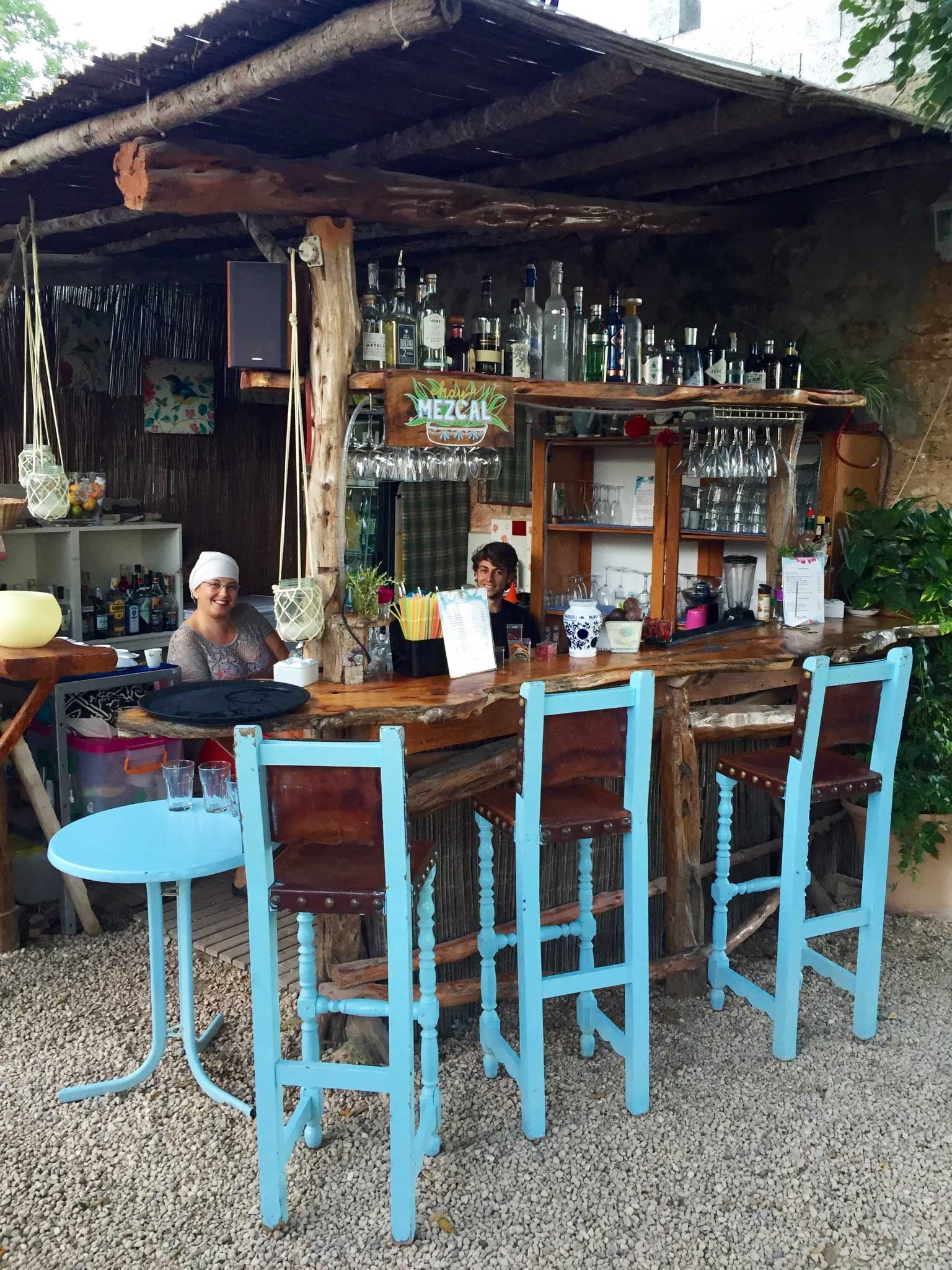 La Paloma family sitting at an outdoor wooden bar