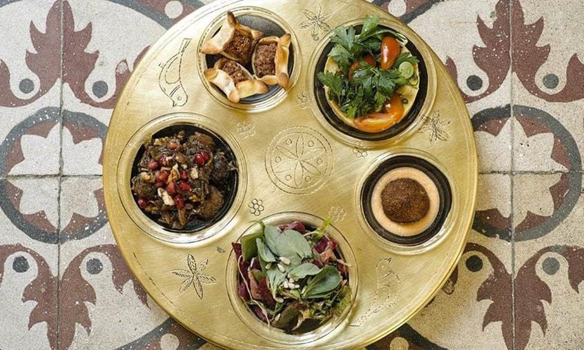 A five-component meal served in a gold dish at restaurant, Liza Beirut