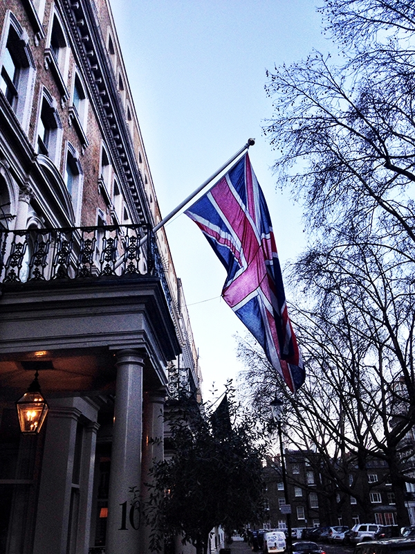 The English flag hangs off the side of a building in London. February 2014