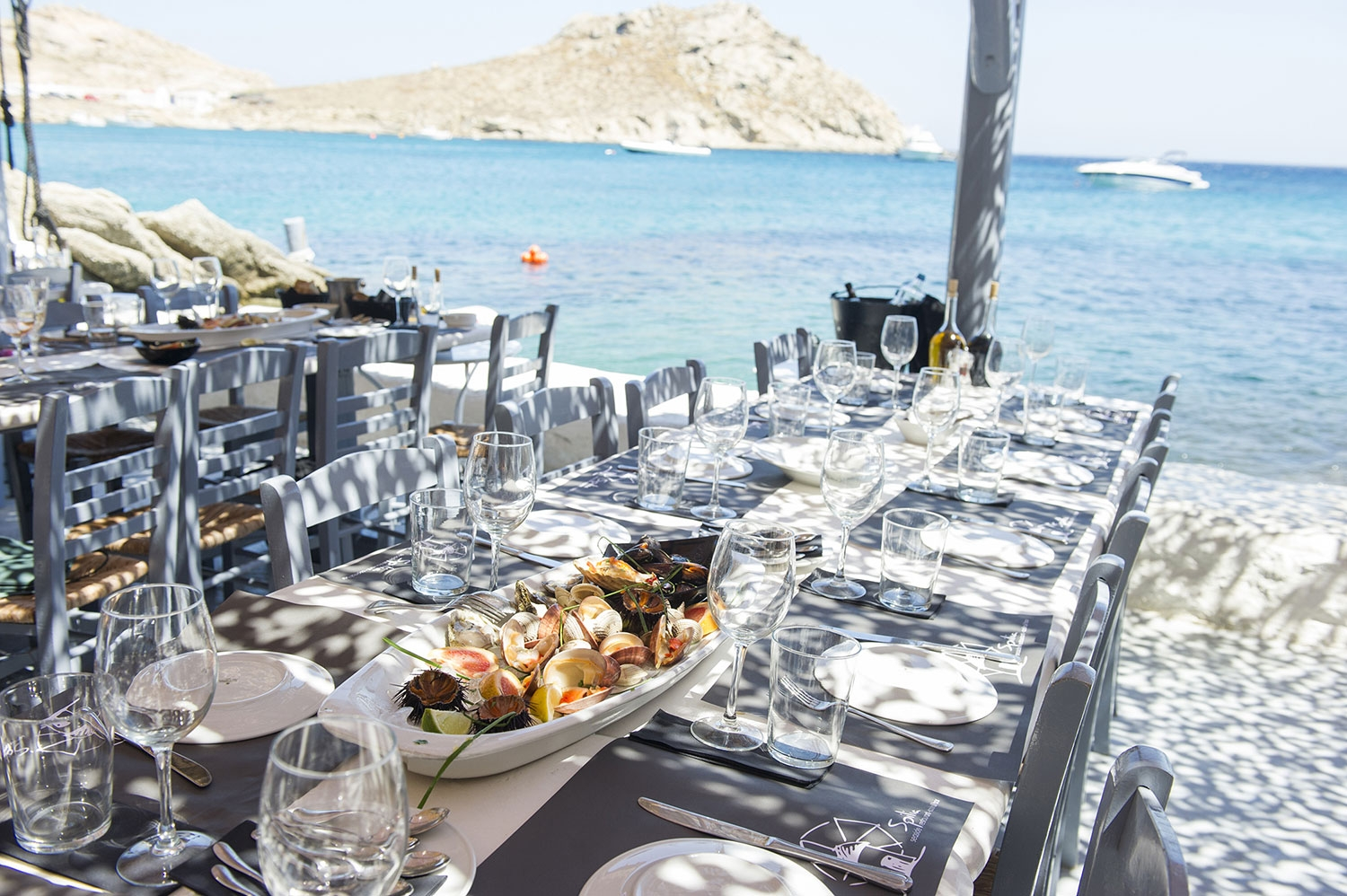 Our favourite restaurant in Mykonos, Spilia, offers long tables by the sea