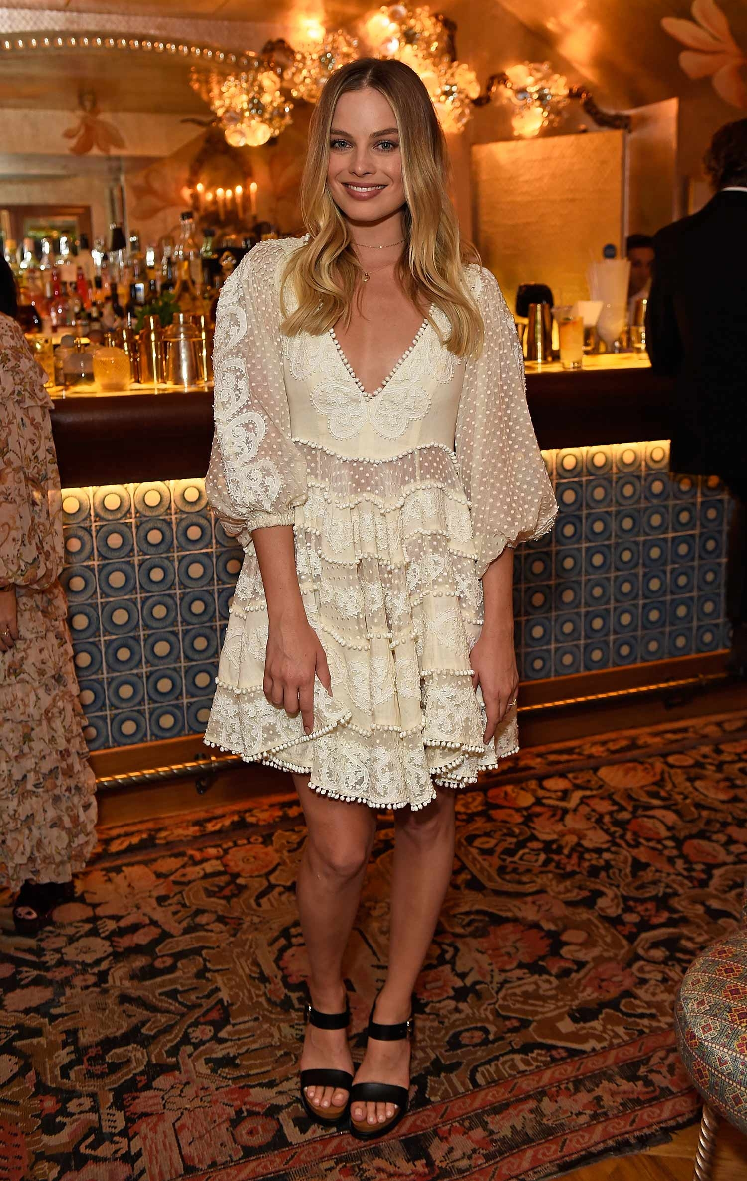 Margot Robbie standing in front of the bar at 5 Hertford Street for an intimate Zimmermann dinner. June 2017