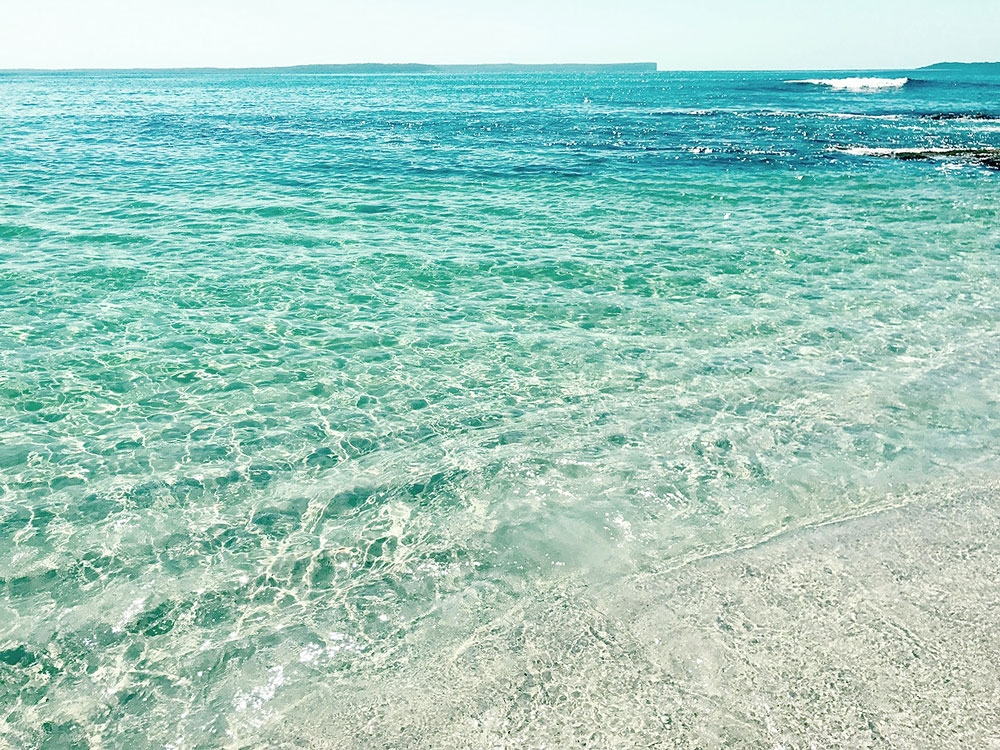 The clear, turquoise waters of Hyams Beach