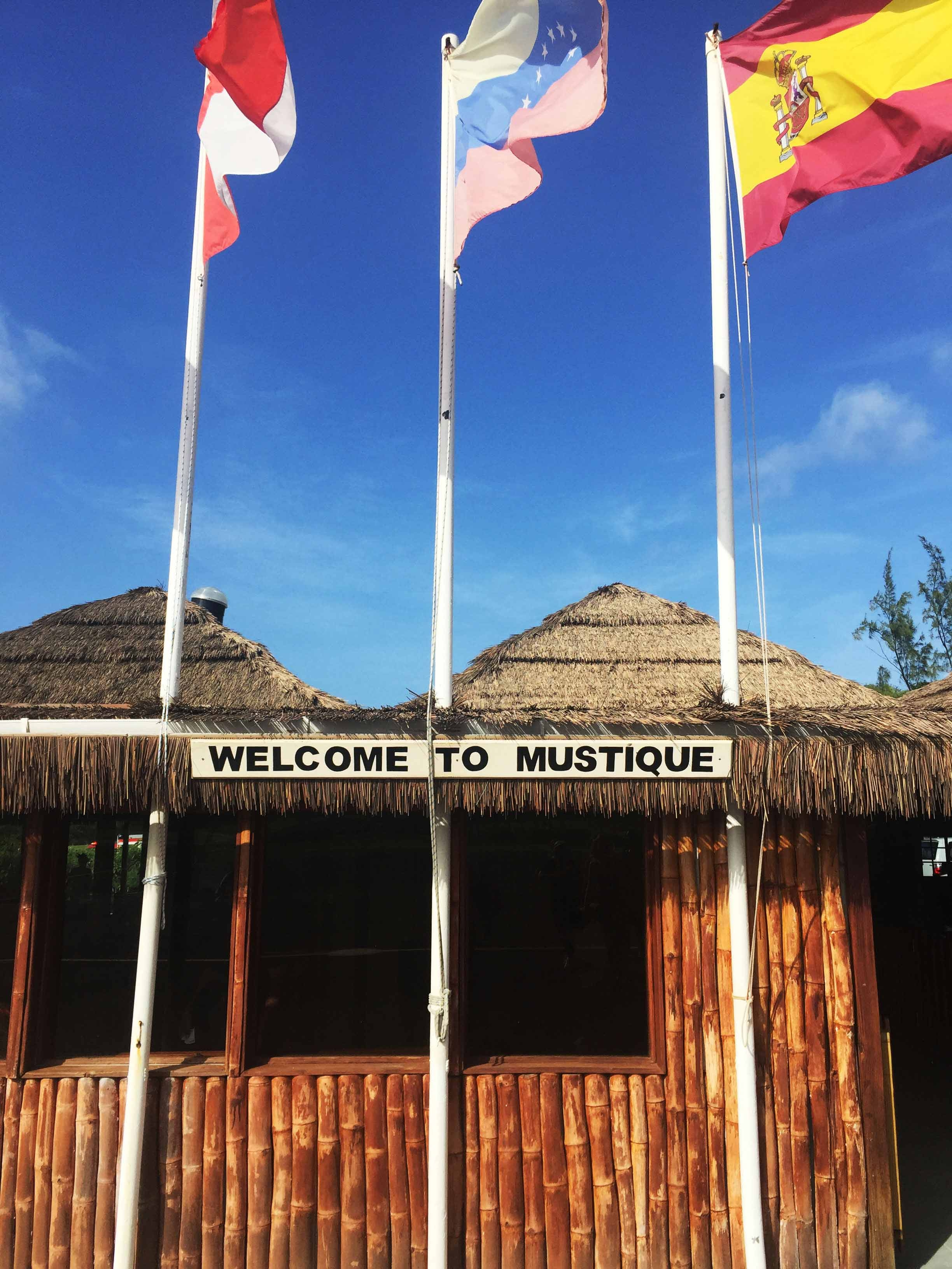 Mustique International Airport is a bamboo hut with three raised flags
