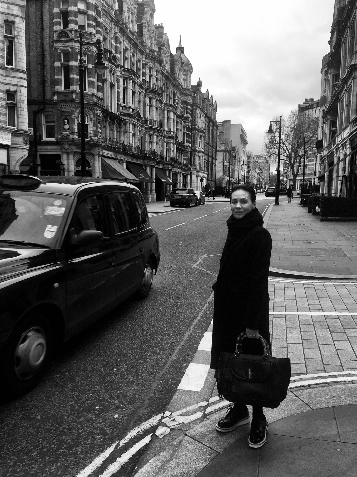 A black and white image of Nicky Zimmermann standing on a street corner in London. March 2016