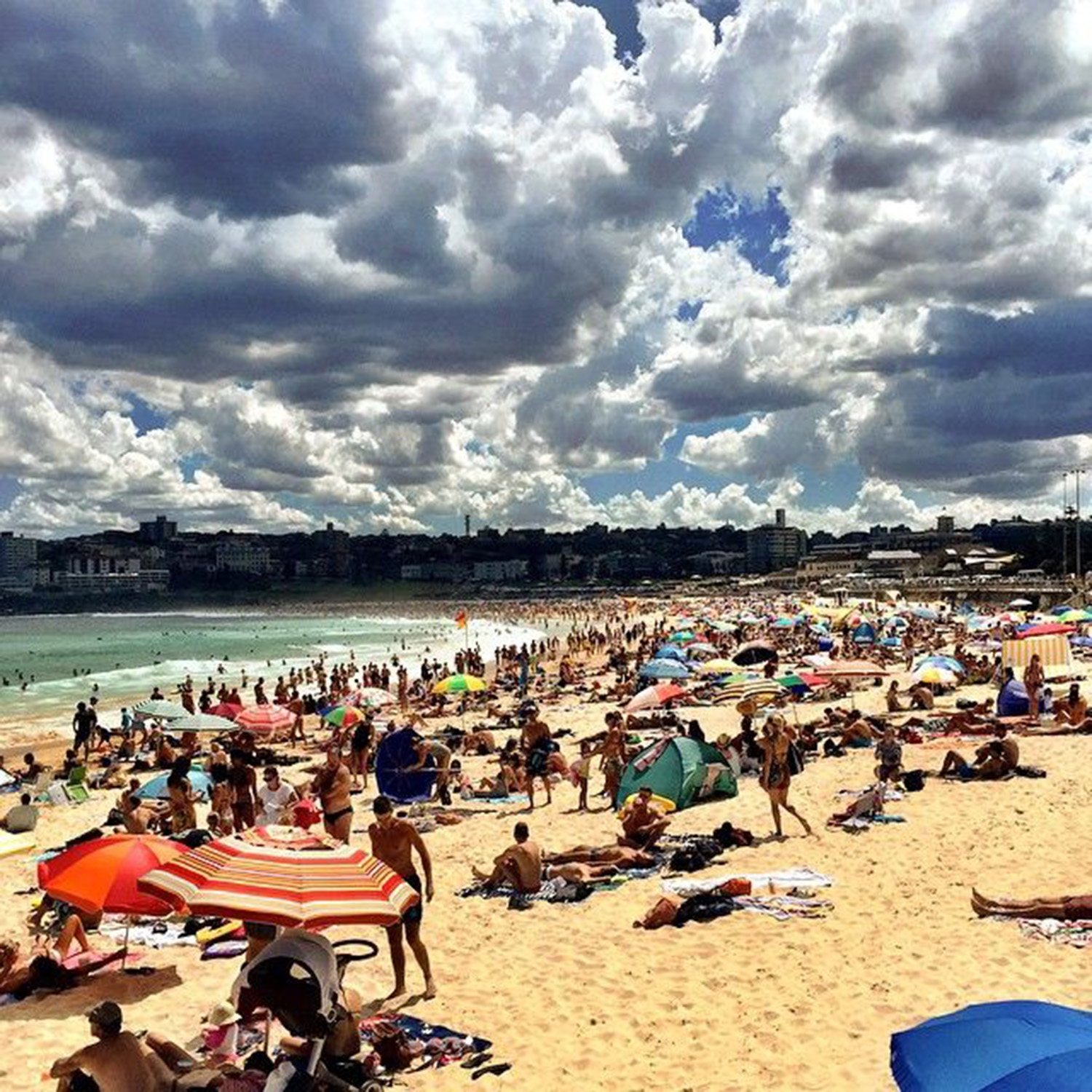 North Bondi filled with swimmers, sunbathers and beachgoers enjoying the sunshine