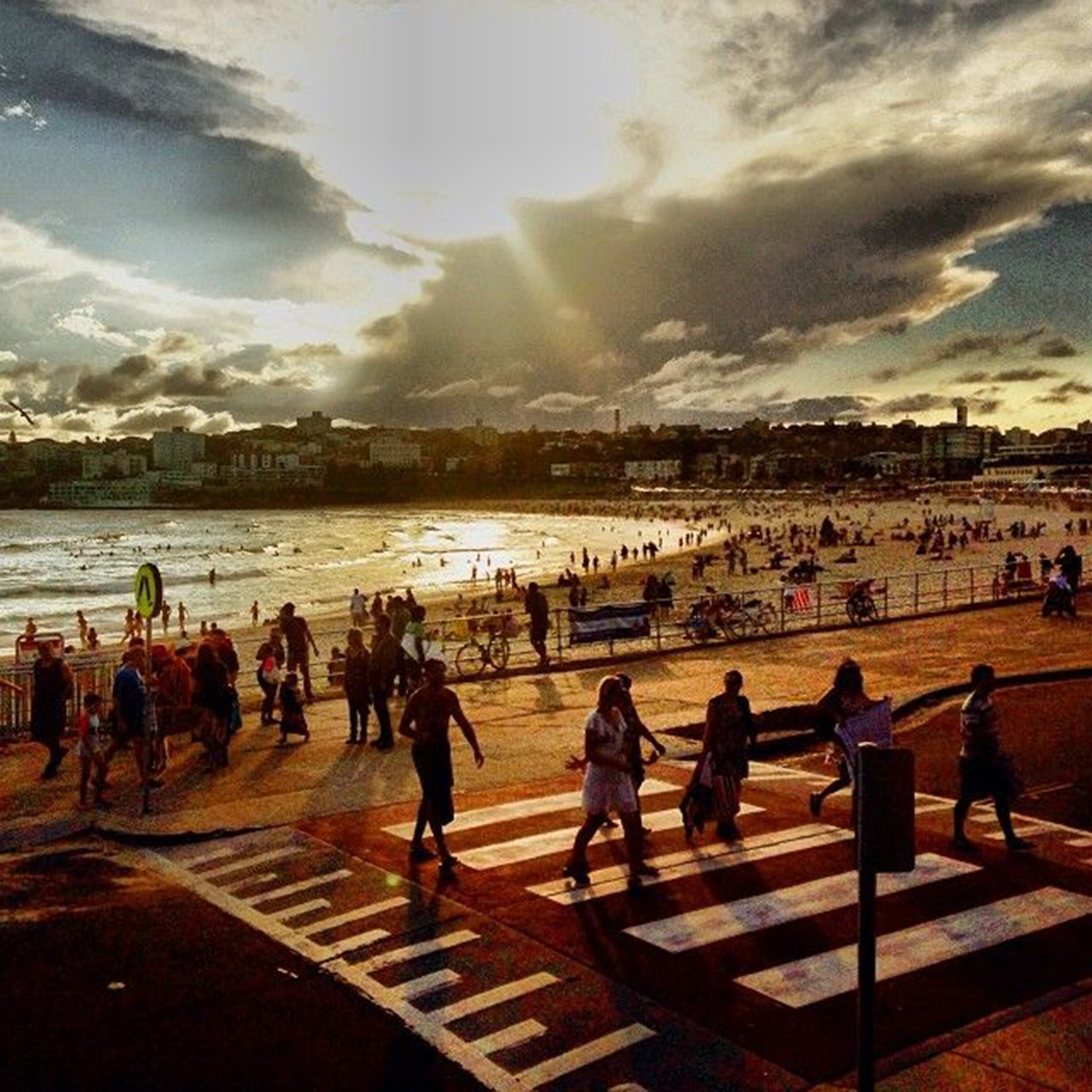 Crowds of people at North Bondi beach at golden hour