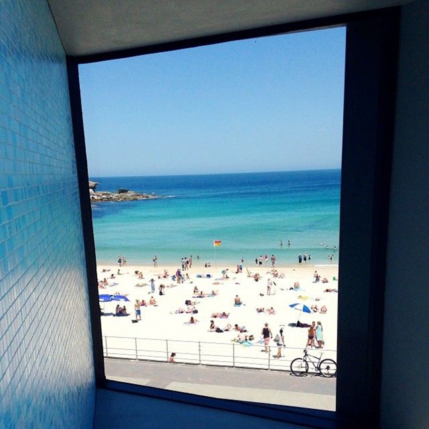 Looking out at the beach from a window in North Bondi Surf Club