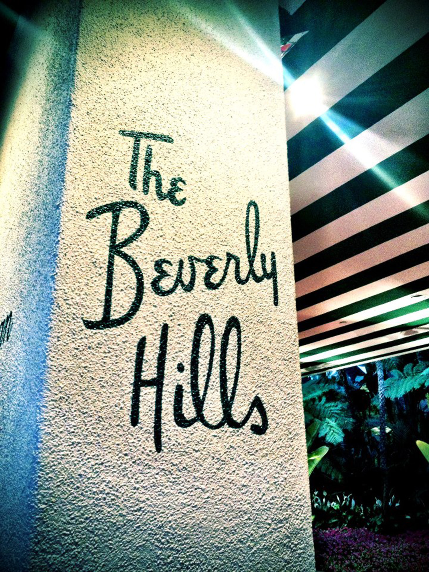 'The Beverly Hills' painted onto a large pole at the Beverly Hills Hotel