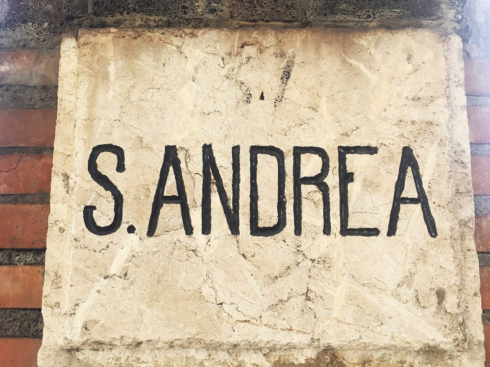 A hand painted sign that reads 'S.ANDREA'