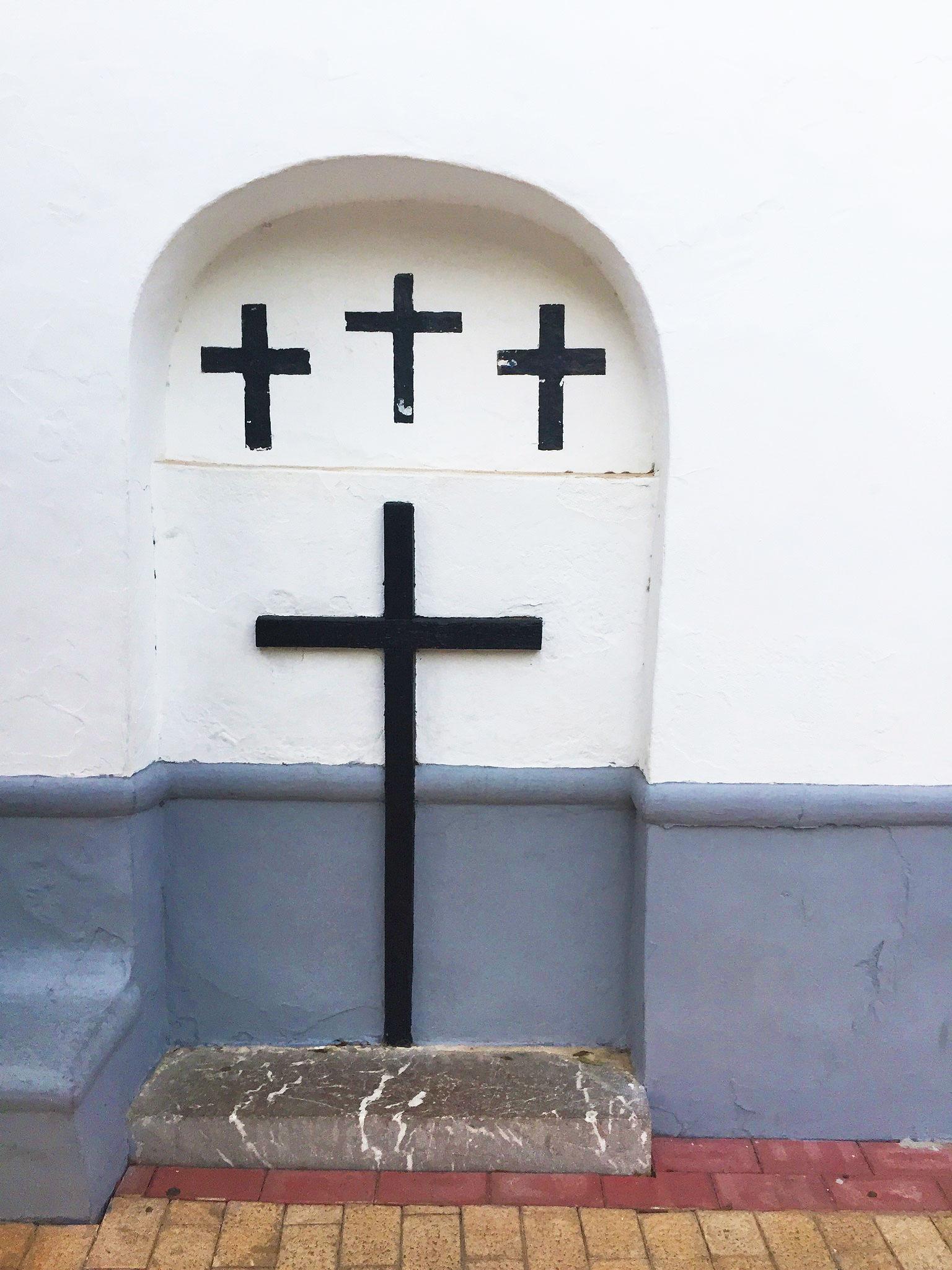 Crosses are hung under an arch at Santa Gertrudis Church