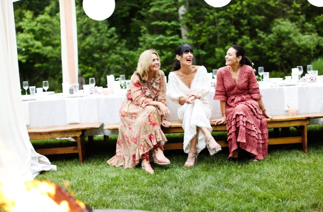 Simone Zimmermann, Anthea Calderone and Nicky Zimmermann sit at an outdoor table, June 2017