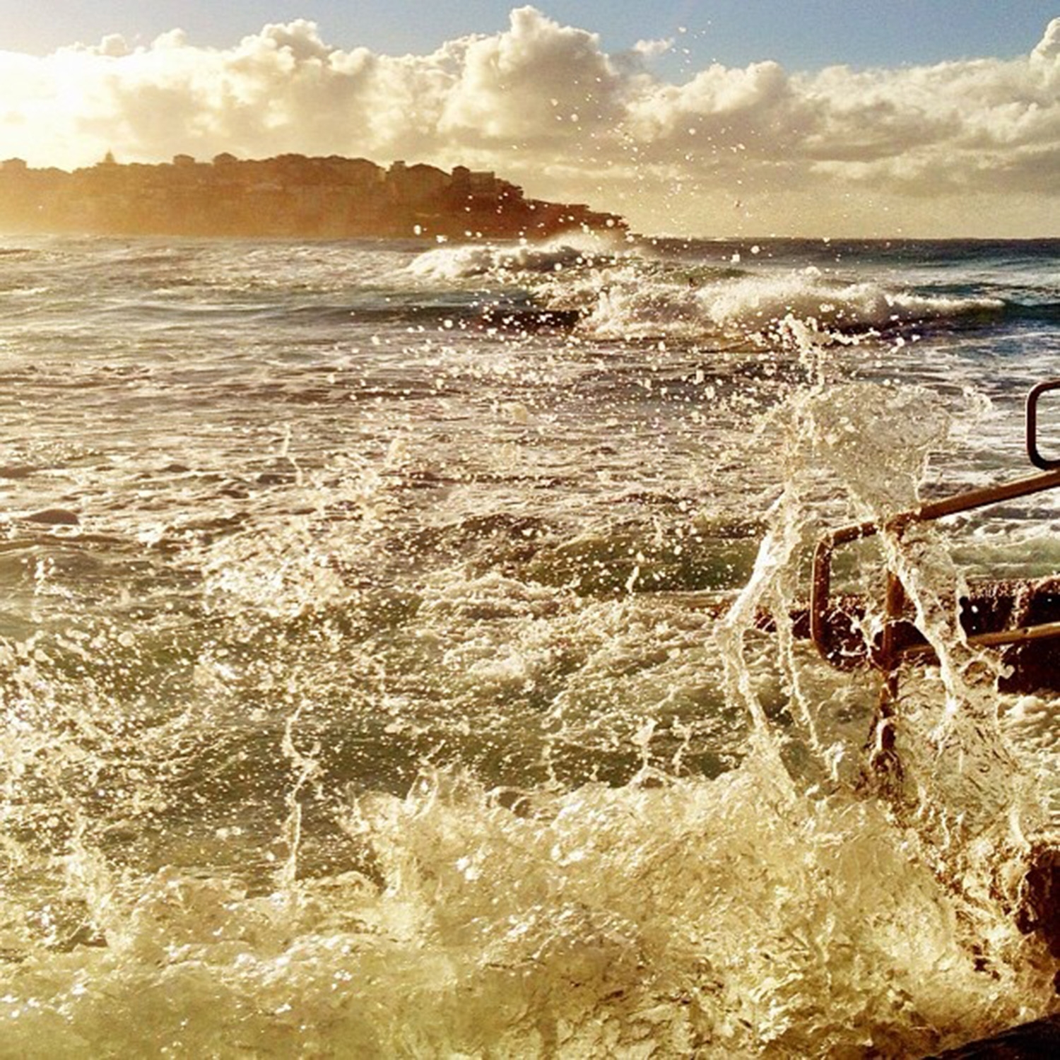 Waves splash during golden hour at South Bondi