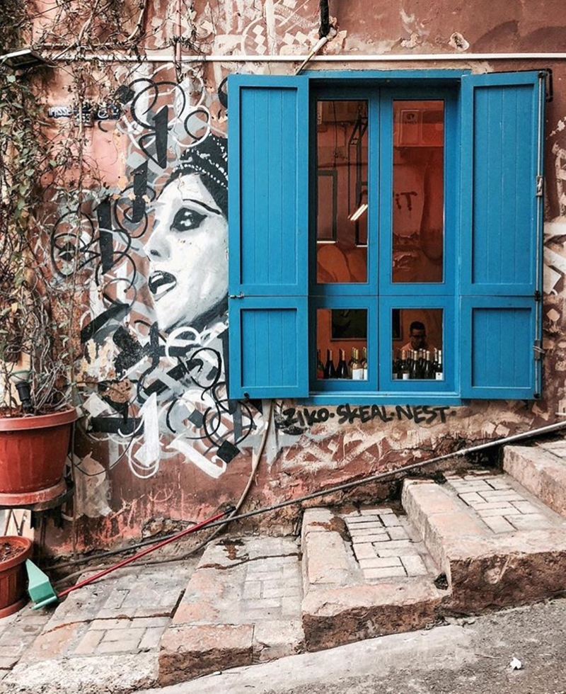 Street art in Beirut consists of a painting of a woman's face surrounded by urban abstract line work