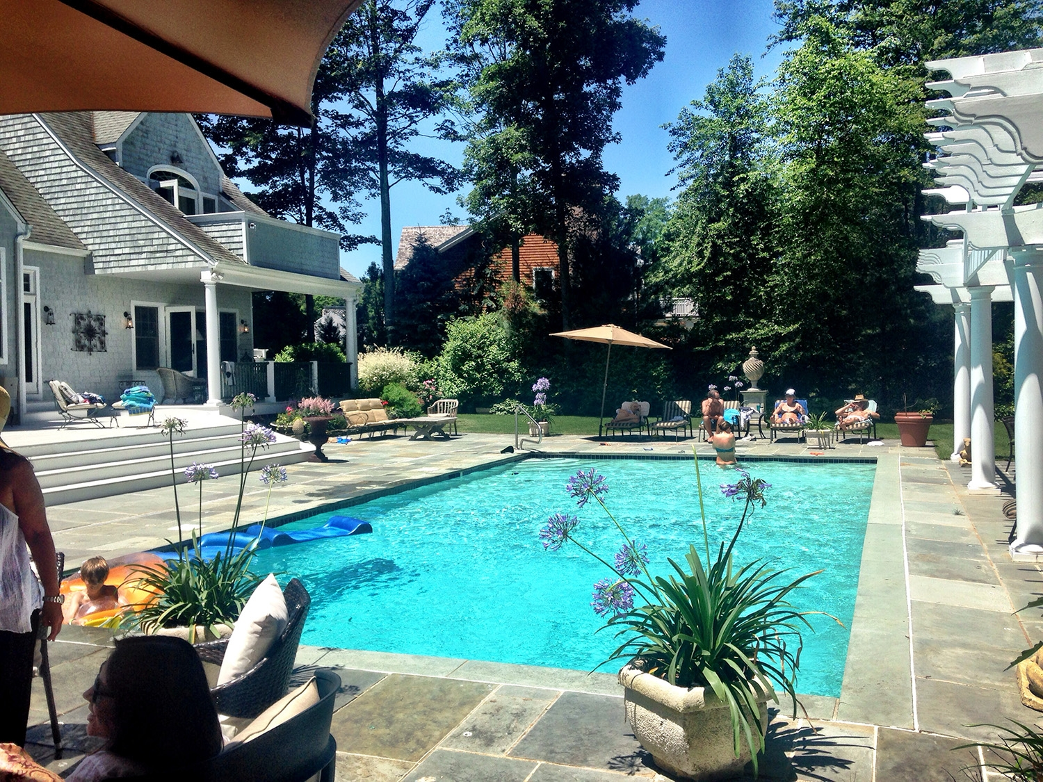 The large pool on a sunny day at a house in East Hampton