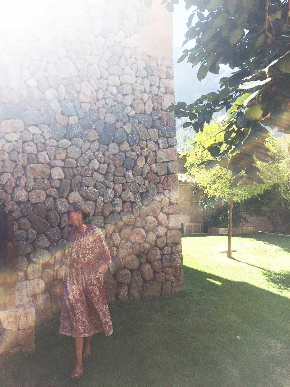 Sophie Lee basks in the sunlight amongst citrus trees