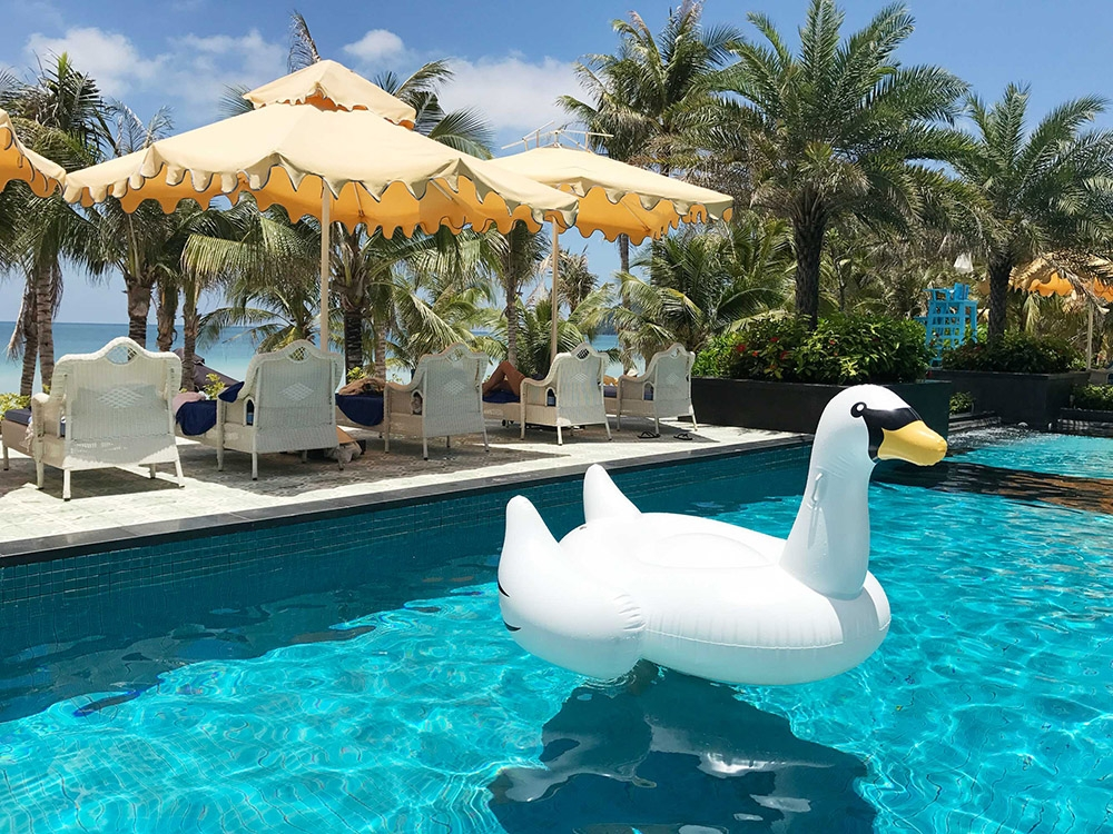 Inflatable pool toys and bright yellow umbrellas at JW Marriott's pool parties