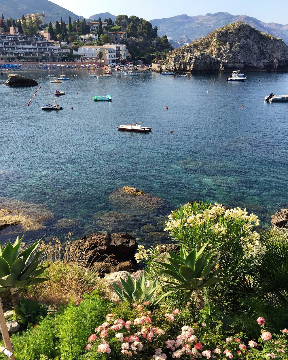 The clear sea and surrounding mountains of Taormina Mare