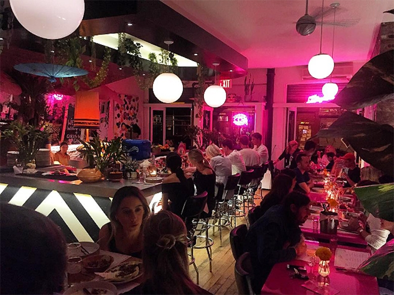 Neon pink lights and monochrome interiors at The Lucky Bee bar. September 2016