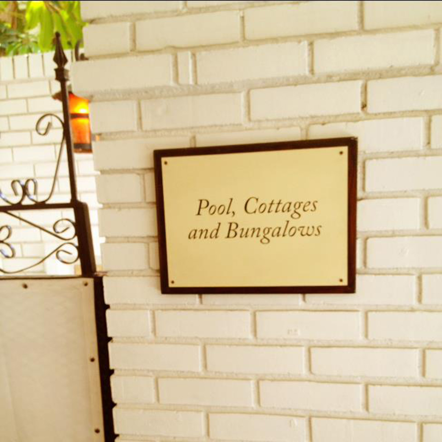 A sign that reads, 'Pool, Cottages and Bungalows', at the Chateau Marmont, July 2012