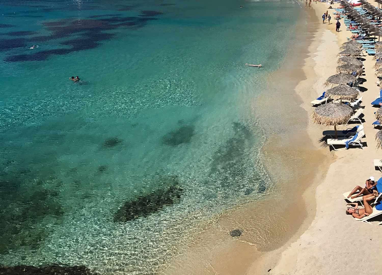 Sun loungers along the coast of Mykonos – the perfect spot to sunbathe. July 2017