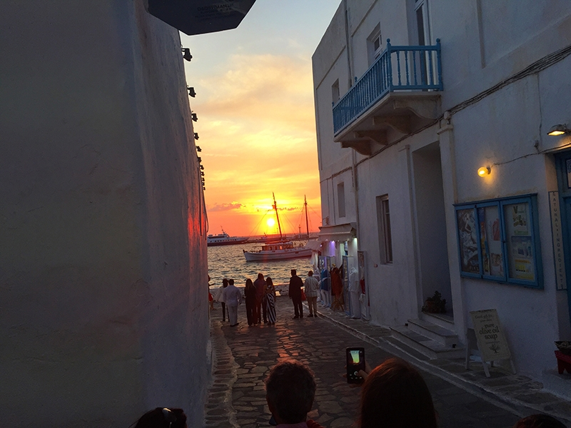 A view of the sunset from an alleyway in Mykonos