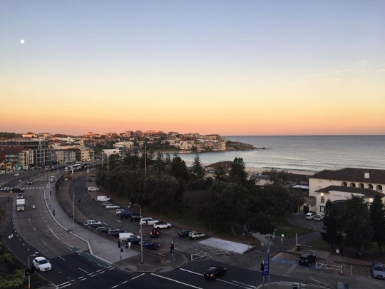 The Bondi ocean and surrounding roads at twilight