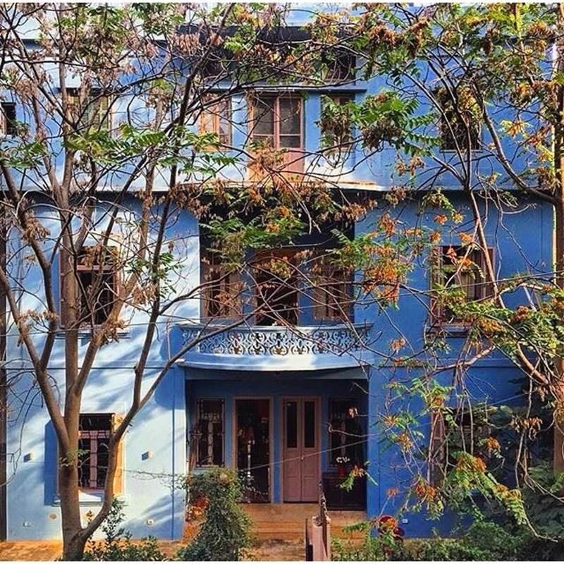 The bright blue exterior of Villa Clara Boutique Hotel