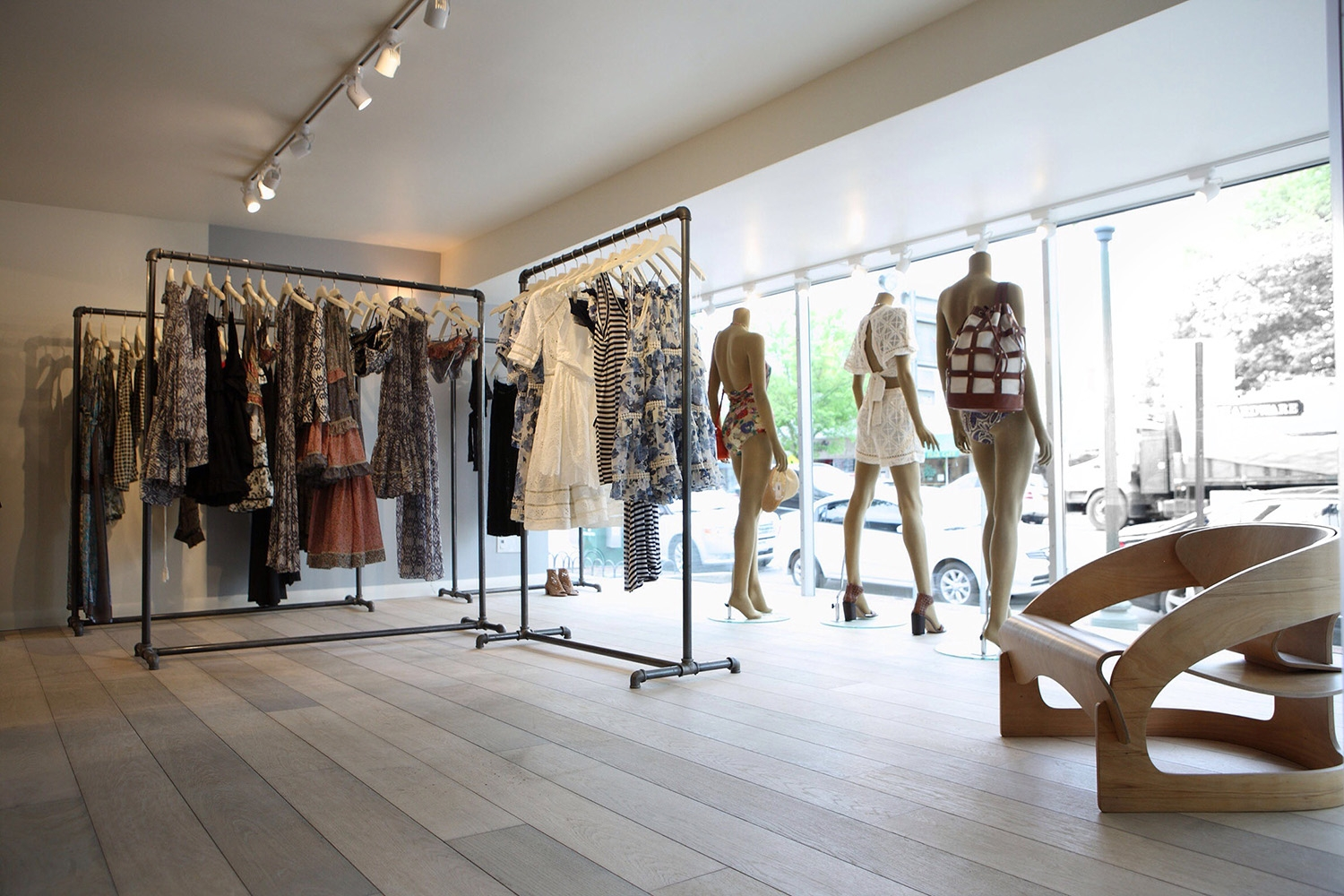 Minimalistic clothing racks and architectural furniture inside our East Hampton store