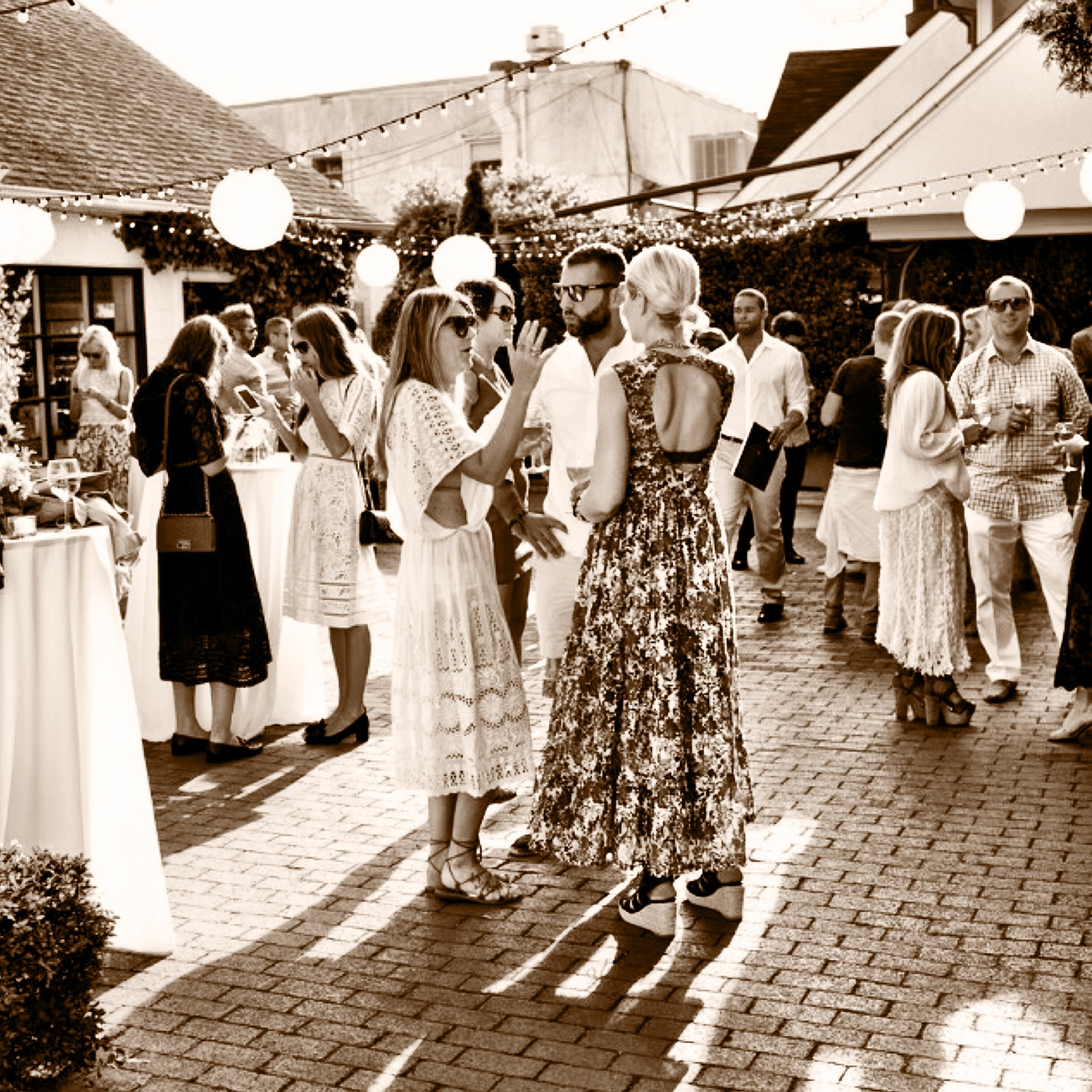 People gathered in a courtyard for Zimmermann's East Hampton Launch, June 2014