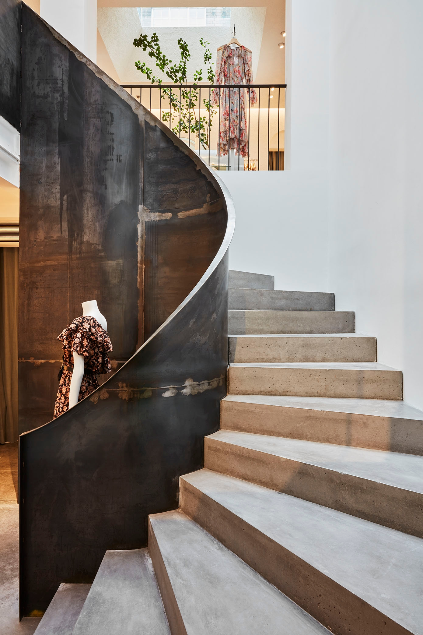 A concrete, half spiral staircase in our Mayfair store leads to second level shopping