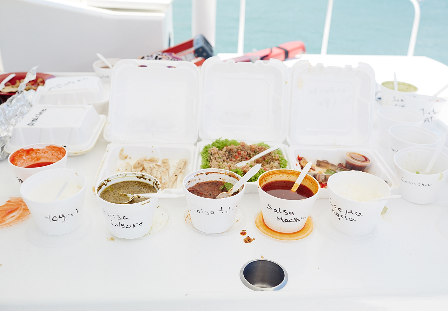 Takeaway containers filled with food for lunch on the yacht